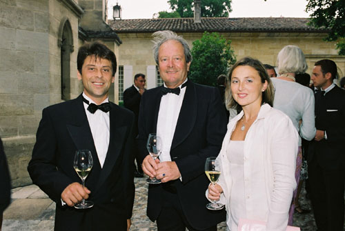Chateau La Gaffelière owner, Leo de Malet-Roquefort (center),  at the château's reception sipping Dom Perignon 1988 / Photo credit:  Groupement de 1er Grands Crus de Saint Emilion